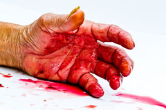 Bloody hand on the table. a violence or fear horror concept. Stock Images