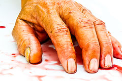 Bloody hand on the table. a violence or fear horror concept. Stock Photos