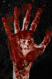 The bloody hand on the wet glass, the bloody window, an imprint of bloody hands, zombie, demon, killer, horror Stock Images