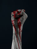 Bloody hand zombie demon. Studio Stock Photos