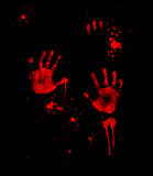 Bloody Handprints. Illustration of bloody handprints with blood spatter on black background Stock Photography