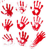 Bloody Hands. A composite of 9 bloody hand prints isolated on white Stock Images