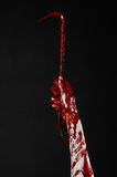 Bloody hands with a crowbar, hand hook, halloween theme, killer zombies, black background, isolated, bloody crowbar Stock Photo