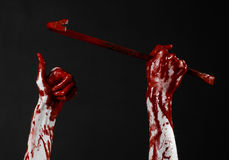 Bloody hands with a crowbar, hand hook, halloween theme, killer zombies, black background, isolated, bloody crowbar Stock Images