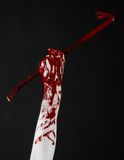 Bloody hands with a crowbar, hand hook, halloween theme, killer zombies, black background, isolated, bloody crowbar Royalty Free Stock Images