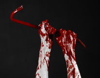 Bloody hands with a crowbar, hand hook, halloween theme, killer zombies, black background, isolated, bloody crowbar Stock Photography