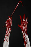 Bloody hands with a crowbar, hand hook, halloween theme, killer zombies, black background, isolated, bloody crowbar Royalty Free Stock Photo