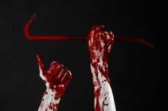 Bloody hands with a crowbar, hand hook, halloween theme, killer zombies, black background, isolated, bloody crowbar Royalty Free Stock Image