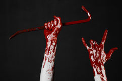Bloody hands with a crowbar, hand hook, halloween theme, killer zombies, black background, isolated, bloody crowbar Royalty Free Stock Photography