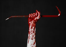 Bloody hands with a crowbar, hand hook, halloween theme, killer zombies, black background, isolated, bloody crowbar. Studio Royalty Free Stock Photography