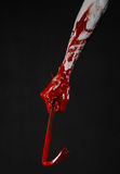 Bloody hands with a crowbar, hand hook, halloween theme, killer zombies, black background, isolated, bloody crowbar Stock Image