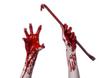 Bloody hands with a crowbar, hand hook, halloween theme, killer zombies, white background, isolated, bloody crowbar Royalty Free Stock Images