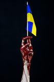 Bloody hands, the flag of Ukraine in the blood, revolution in Ukraine, Black background Royalty Free Stock Image