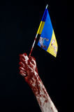 Bloody hands, the flag of Ukraine in the blood, revolution in Ukraine, Black background Royalty Free Stock Photography