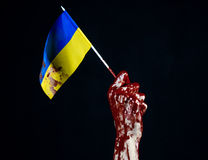 Bloody hands, the flag of Ukraine in the blood, revolution in Ukraine, Black background Royalty Free Stock Images