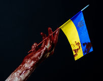 Bloody hands, the flag of Ukraine in the blood, revolution in Ukraine, Black background Stock Photo
