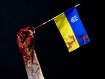 Bloody hands, the flag of Ukraine in the blood, revolution in Ukraine, Black background Stock Photography