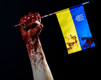 Bloody hands, the flag of Ukraine in the blood, revolution in Ukraine, Black background Stock Images
