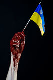 Bloody hands, the flag of Ukraine in the blood, revolution in Ukraine, Black background Royalty Free Stock Photo