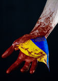 Bloody hands, the flag of Ukraine in the blood, revolution in Ukraine, Black background Royalty Free Stock Photos