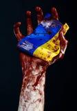 Bloody hands, the flag of Ukraine in the blood, revolution in Ukraine, Black background Stock Photos