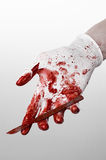 Bloody hands in gloves with the scalpel, white background, isolated, doctor, killer, maniac. Studio Royalty Free Stock Photo