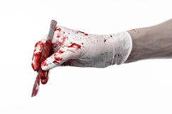 Bloody hands in gloves with the scalpel, white background, isolated, doctor, killer, maniac Stock Photography