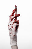 Bloody hands in gloves with the scalpel, white bac Royalty Free Stock Photography