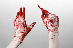Bloody hands in gloves with the scalpel, white background, isolated, doctor, killer, maniac Stock Images