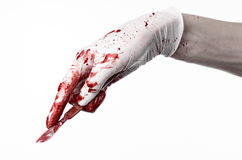 Bloody hands in gloves with the scalpel, white background, isolated, doctor, killer, maniac. Studio Royalty Free Stock Photos