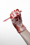 Bloody hands in gloves with the scalpel, white background, isolated, doctor, killer, maniac Royalty Free Stock Photography