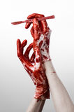 Bloody hands in gloves with the scalpel, white background, isolated, doctor, killer, maniac Royalty Free Stock Photos