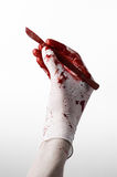 Bloody hands in gloves with the scalpel, white background, isolated, doctor, killer, maniac Royalty Free Stock Images