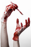 Bloody hands in gloves with the scalpel, white background, isolated, doctor, killer, maniac. Studio Royalty Free Stock Images