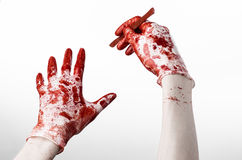 Bloody hands in gloves with the scalpel, white background, isolated, doctor, killer, maniac Stock Photos