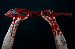Bloody hands with a machete zombie demon maniac knife