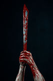Bloody hands with a machete zombie demon maniac knife Royalty Free Stock Photography