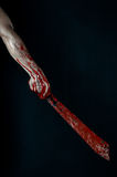 Bloody hands with a machete zombie demon maniac knife Royalty Free Stock Photos