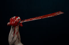 Bloody hands with a machete zombie demon maniac knife Stock Photos