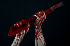 Bloody hands with a machete zombie demon maniac knife Royalty Free Stock Image