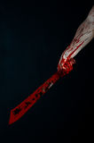 Bloody hands with a machete zombie demon maniac knife. Studio Stock Photography