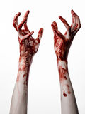 Bloody hands on a white background, zombie, demon, maniac, isolated. Studio Royalty Free Stock Photo