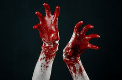 Bloody hands in white gloves, a scalpel, a nail, black background, zombie, demon, maniac Royalty Free Stock Image