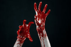 Bloody hands in white gloves, a scalpel, a nail, black background, zombie, demon, maniac Royalty Free Stock Images