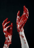 Bloody hands in white gloves, a scalpel, a nail, black background, zombie, demon, maniac Stock Image