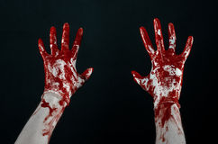 Bloody hands in white gloves, a scalpel, a nail, black background, zombie, demon, maniac Royalty Free Stock Photography