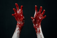 Bloody hands in white gloves, a scalpel, a nail, black background, zombie, demon, maniac. Studio Royalty Free Stock Photo