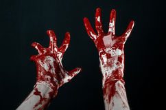 Bloody hands in white gloves, a scalpel, a nail, black background, zombie, demon, maniac. Studio Stock Photography