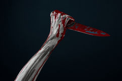 Bloody hands zombie demon knife Stock Image