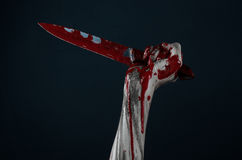 Bloody hands zombie demon knife Stock Photo